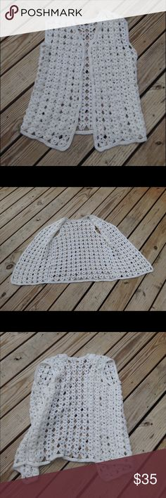 VINTAGE WHITE CROCHET FESTIVAL HIPPIE BOHO VEST Gorgeous handmade vest. Vintage. Just add a cute belt for a boho hippie look. One size but will fit a bigger size as well. One of a kind piece! Sweaters