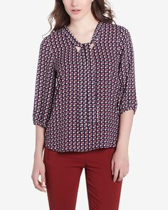 The Printed Bow Blouse is made of pure polyester. It's styled with a floppy necktie, 3/4 sleeves and a high-low hem. Pair this original top with skinny jeans or dress pants for a trendy look.