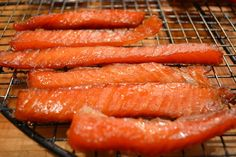 Candied Smoked Salmon Jerky Recipe  Author: Kwin and Matt  Ingredients  2 lbs of Sockeye, King or Steel-Head Salmon 3 Cups of brown Sugar 1/2 Cup Kosher Salt 1 Tablespoon Minced Garlic Fireball Whiskey For basting    Instructions: Mix the brown sugar, kosher salt and garlic together. Lay the