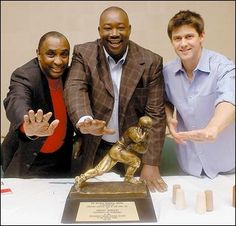 Nebraska Huskers' 3 Heisman winners, Johnny Rodgers (1972), Mike Rozier (1983) and Eric Crouch (2001)
