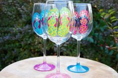 Perfect gift for the beach lover. Bright, colorful and fun. Each glass is hand painted and unique. Flip flop and base colors are the same, but actual design on each flip flop varies from glass to glass. When ordering, select 3 different flip flop colors.
