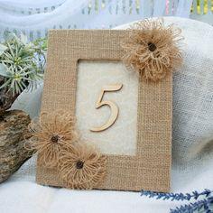 Rustic Wedding Table Numbers 1 thru 10.  Burlap covered frames with burlap flowers. Circle25Designs, $150.00