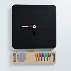 Blackboard clock with hidden drawer that holds all the chalk. Sweet!
