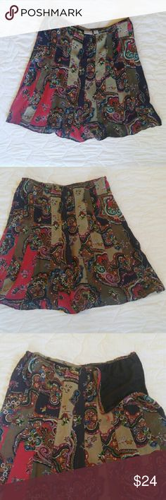 Chico's A-line circle skirt Chico's Multi-colored Paisley skirt. Chicos size 2 = size 10-12. 100% silk, with a polyester lining. Invisible side zipper. Chico's Skirts Circle & Skater