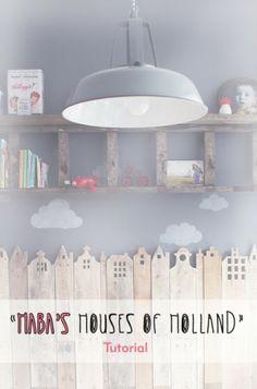 Huisjes van palethout op de muur met licht erachter, leuk voor de kinderkamer