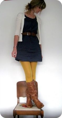 Navy blue and mustard yellow outfit combo / navy blue dress and mustard yellow tights.