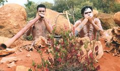 Aboriginals playing the Yerike or Didjeridoo to pay respect to the earth, moon and sky. Australia  Photo by Elisa Kotin
