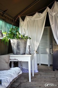 Love the draped white fabric-adds instant drama-memories of those sheet tents we made when we were kids