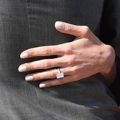 Brides.com: . Amal Alamuddin-Clooney's Engagement Ring. George Clooney's retreat from eternal bachelorhood shocked the world, but his gorgeous and incredibly smart new wife seems to be his perfect match. To solidify their union, Clooney gave Amal a huge emerald-cut diamond engagement ring.