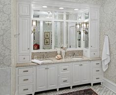 The Woodshop of Avon traditional bathroom. double vanity and tall cabinets on top of the counter on the sides.