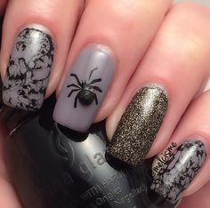 Halloween Nails by iG user: melcisme - cool scary nails with a bejewelled spider and nice marbling effect...x