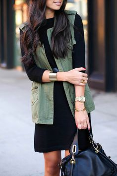 Olive green vest with black dress and gold accessories