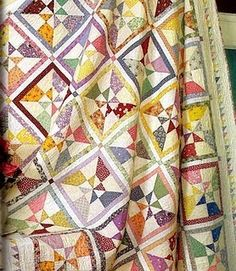 Looks like you sew strips, cut so there are two rectangles, cut into half-square triangles and sew together....makes a nice scrappy-but-planned look