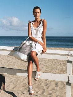 Minimalists will want to trade in the big-city black they wear all winter for clean, chic, all-season-long whites. Alessandra Ambrosio wears Tod'sfringed-leather sandals ($675) and dress; Tod's boutiques. Pierre Hardy cutout-leather bag, $1,595; Pierre Hardy, NYC. Hermès silver bracelet; Hermès boutiques.Beauty note:Suave Professionals Visible Glow Self-Tanning BodyLotion builds color gradually for a healthy summer sheen.
