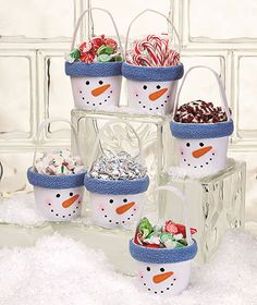 Cute holiday gift idea- these would be easy to make with flower pots or a tin/pail, paint and fleece to go around rim. You could even put the person or family's name you are giving it to around the rim with some felt letters if you desire! One more idea- display these on a dessert table for example, maybe a sundae bar and each snowman holds a different topping!