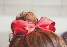messy bun with red ribbon