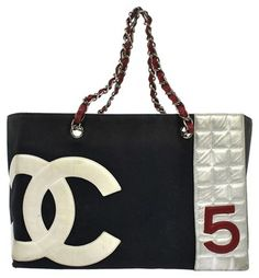 Chanel Cc No5 Chain Hand Canvas Vintage Italy Navy, White, Gray, Red Tote Bag. Get one of the hottest styles of the season! The Chanel Cc No5 Chain Hand Canvas Vintage Italy Navy, White, Gray, Red Tote Bag is a top 10 member favorite on Tradesy. Save on yours before they're sold out!