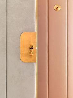 J&M Davidson by Universal Design Studio uses brass door furniture.