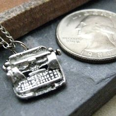 tiny pewter typewriter- I like this pin; I'm always searching antique stores for pewter minitures
