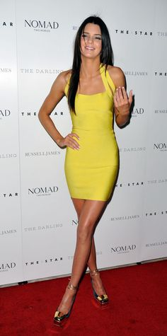Kendall Jenner in a stunning yellow dress.