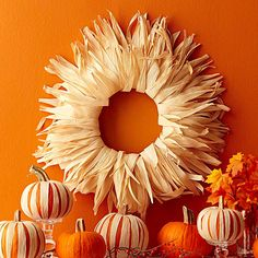 Rim a wreath with cornhusks to mimic the golden autumn sun: http://www.bhg.com/thanksgiving/outdoor-decorations/holiday-wreaths/?socsrc=bhgpin092814cornhuskwreath&page=15