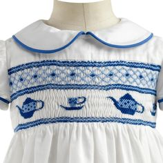 This is an adorable little dress with smocking....Cups and Teakettles are so cute....