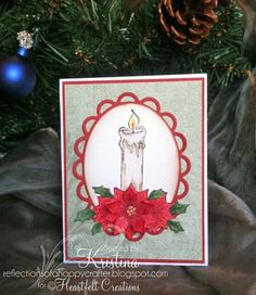 Candle and poinsettia in Lacy Oval