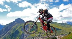 A freestyle #mountain #bike rider takes huge air at the bottom of Whistler mountain in the terrain #park