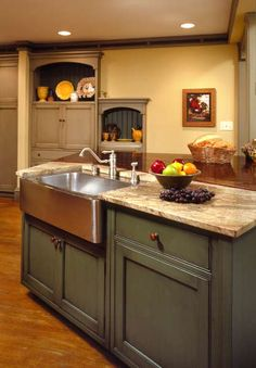 another green cabinet idea.  Not sure of the cabinet colors in the background but, notice, no natural light.  Gives me a good idea on how it may look in my house.