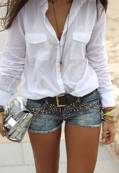 I love everything about this from the breezy white cotton button down open,  the blinged out cut-off denim shorts, leather belt, silver metalic handbag and piles of bracelets!!  Summer sexiness!  From Boho to Chic: Embellished Shorts