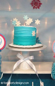 Snowflake cake at a Frozen birthday party! See more party ideas at CatchMyParty.com!
