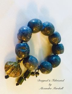 This chunky natural Blue Coral and Pyrite Bracelet by Alexandra Marshall is hand knotted and has a discreet sliding knot closure which adjusts to fit most wrists. This one was custom made for Myra. For details about a similar piece reference #2289, and email: xmarshallm@aol.com
