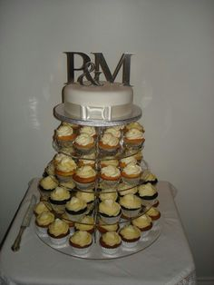 Wedding cupcake tower with top cake Cupcake Tower Wedding, Wedding Cupcakes, Desserts, Top, Tailgate Desserts, Dessert, Postres, Deserts, Shirts