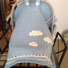 Crochet baby car seat cover. Blue and clouds. By Janene