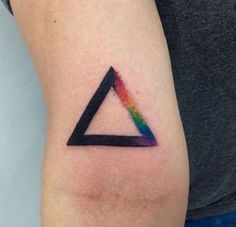 Minimalist Triangle Glyph Tattoo design. The simple bold triangle design makes it look very powerful and strong. There are also hints of colors on one side that mimics that of a rainbow.