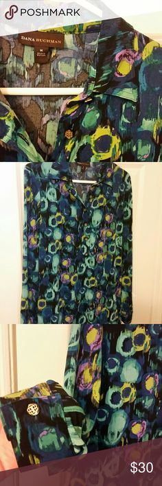 Beautiful tunic by Dana Buchman Watercolor print with shades of blue, green, and purple. Gold logo buttons at the neck and sleeves. Tunic length, fabric is substantial and forgiving ;) Dana Buchman Tops Tunics