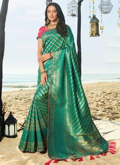 Bottle green saree with blouse. Work - Heavy weaving and embroidery on saree with embroidery work on blouse. Paired with the matching blouse piece. Designer Silk Sarees, Latest Designer Sarees, Wedding Sarees Online, Saree Wedding, Bottle Green Saree, Latest Saree Trends, Sari Shop, Vintage Fashion Photography, Party Wear Sarees