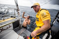 March, 2015. Leg 5 to Itajai onboard Abu Dhabi Ocean Racing. Day 01. Justin Slattery tells Ian all is clear as Louis Sinclair pulls himself up out of the water after diving the length of the hull to remove debris from the keel, prop, and rudder - Matt Knighton / Abu Dhabi Ocean Racing / Volvo Ocean Race