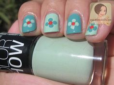 Maybelline Color Show in Mint Mojito on middle and pinkie fingers, Coral Glow in the center of flower.