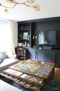 Learn how to create the ultimate game room Create a game room in plain sight with DIY living room built-ins and a DIY coffee table with pullouts Home Made by Carmona Game Room Decor, Living Room Decor, Table In Living Room, Living Room Units, Living Room Built Ins, Storage In Living Room, Diy Casa, Game Room Design, Living Room Remodel