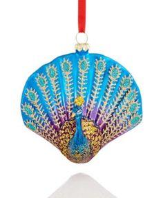 Holiday Lane Peacock Ornament - Christmas Ornaments - For The Home - Macy'sPretty as a peacock! This molded glass Peacock Tail ornament from Holiday Lane makes for a lively addition to your Christmas tree, with the peacock's head attached in resin. Seashell Painting, Seashell Art, Seashell Crafts, Beach Crafts, Peacock Painting, House Ornaments, Christmas Tree Ornaments, Christmas Crafts, Xmas Tree