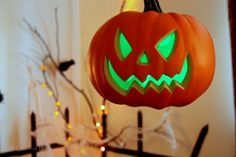 Floating Jack-o-lanterns....light weight plastic, lit by a glow stick and hung from ceiling with clear push pins and invisible thread. <3