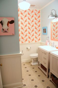 Lesli gutted her kids' bathroom room and started from scratch. She designed the space herself and added an additional sink. Lesli removed the claw-foot tub, and put in a tub and shower, tiled and got industrial school house lighting. Now the room is functional and easy to clean! Visit My Old Country House for more... Read More »