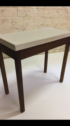 Handcrafted solid beech wood occasional table, with cream polished concrete top. #sidetable #coffeetable #modernfurniture #contemporarytable #concretetabletop