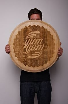 Wooden wine barrel lid goes typography art.