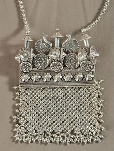 Silver purse ~ via Jaypore
