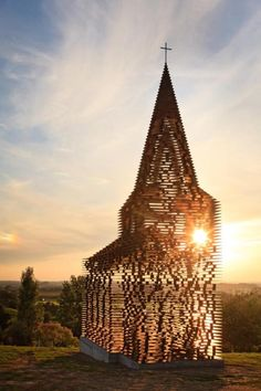 Church in Borgloon, Belgium by Gijs Van Vaerenbergh Architects. At 10 meters high, the church is composed of 100 thin sheets and 2,000 column of steel. With a staggered, stacked construction, the exterior landscape is visible through the 'walls' of the church.
