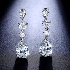 This beautiful chandelier teardrop dangle earrings is individually handcrafted with sparkling cubic zirconia diamond. We use top grade AAA swiss-made CZ, the earrings is eco-friendly and does not contain lead, nickel or cadmium. It features high quality white gold rhodium plated for tarnish resistance and a long lasting mirror finish.