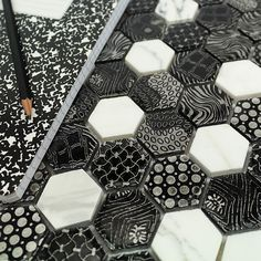 Black and white patterned hexagon tile