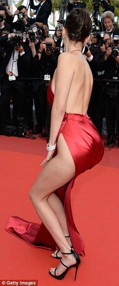 The 19-year-old beauty stole the show in an extremely racy red gown which showed off every inch of her phenomenal frame while blatantly exhibited her choice to forego underwear